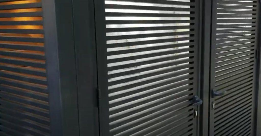 Black Aluminium Fence with Door Opening Feature