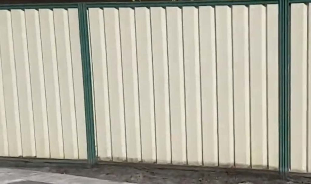 White & green Colorbond fence
