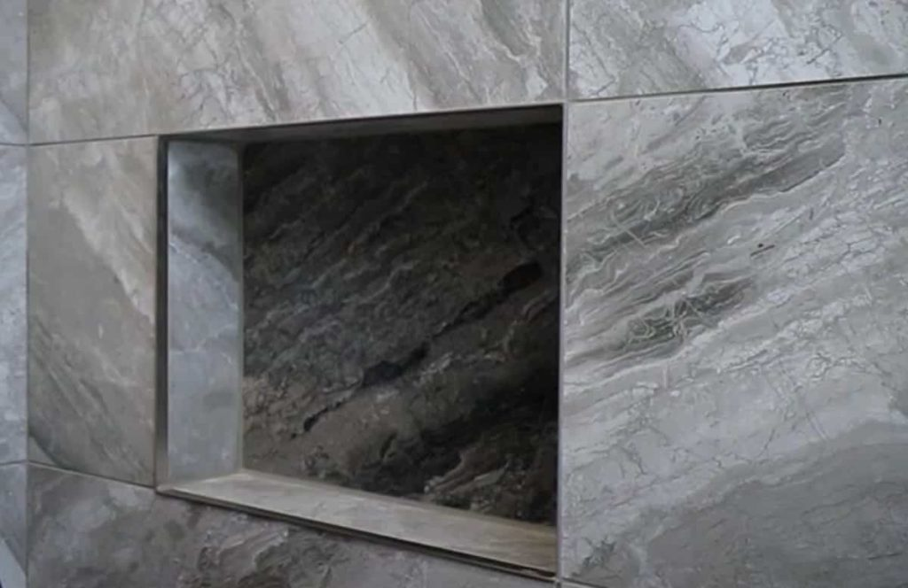 shower recess on marble style wall